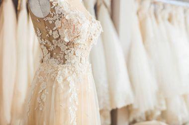 Elegant lace dress on dummy in wedding fashion shop