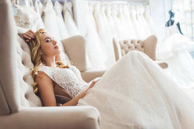 Attractive bride in tulle dress in wedding fashion shop