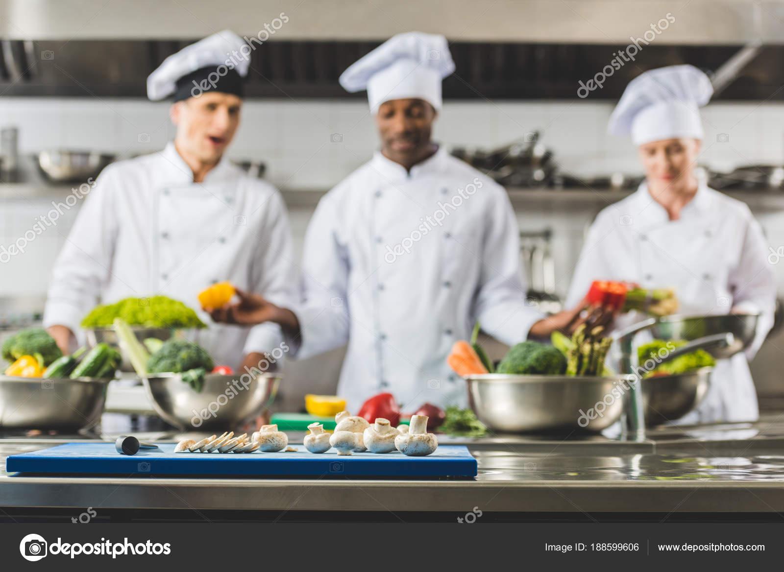 Multicultural Chefs Restaurant Kitchen Vegetables Foreground — Stock ...
