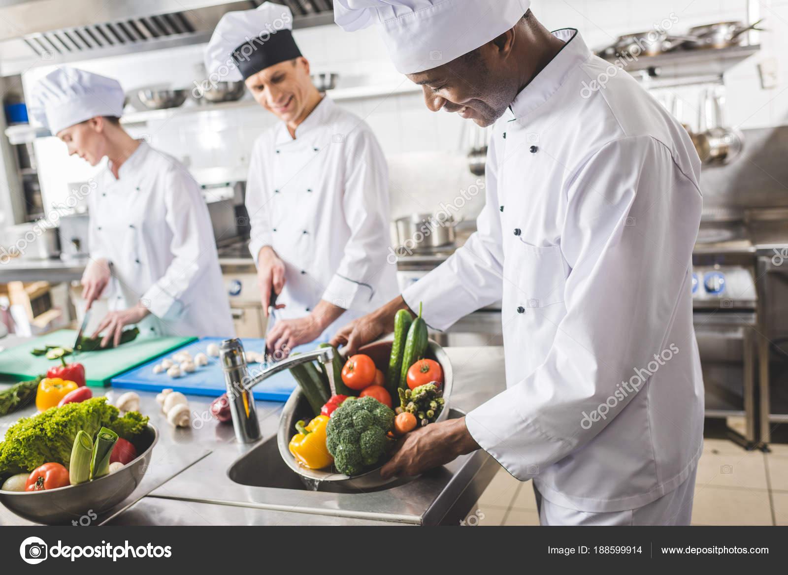 Smiling African American Chef Washing Vegetables Restaurant Kitchen ...