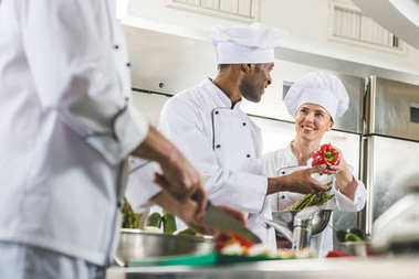 multicultural chefs at work in restaurant kitchen