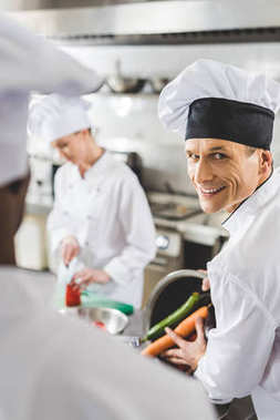 multicultural chefs cooking at restaurant kitchen