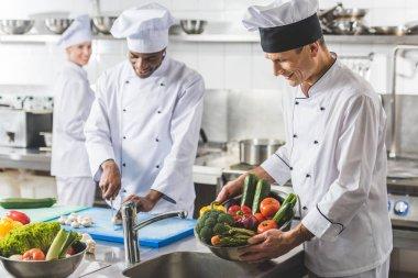 multicultural chefs preparing at restaurant kitchen