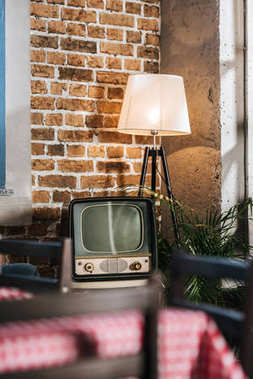 vintage tv with blank screen in 1950s style interior