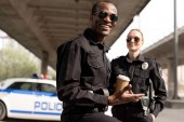 Photo happy young police officers having coffee break