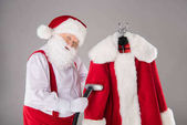 Photo Santa Claus cleaning coat