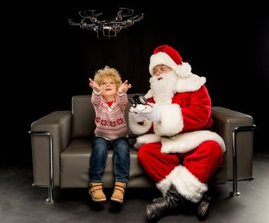 Santa Claus with child using hexacopter drone