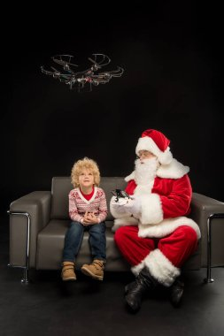 Santa Claus using hexacopter drone with child