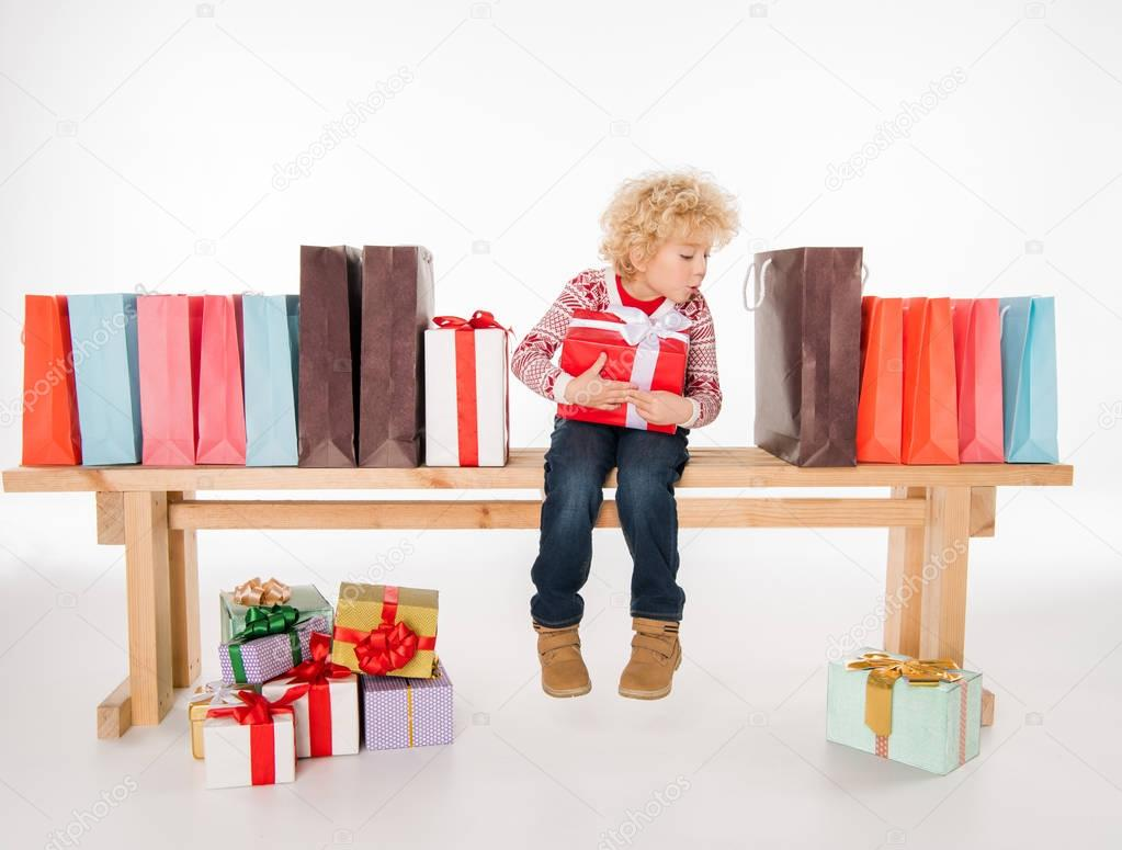 Kid with pile of gift boxes