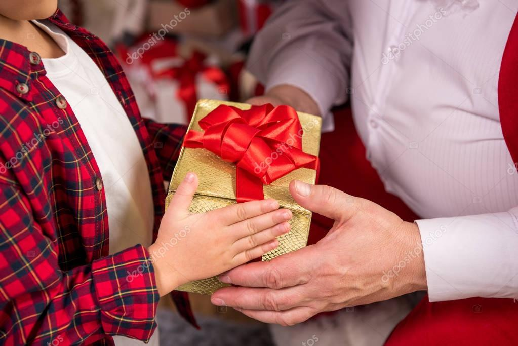 Santa Claus giving present to child