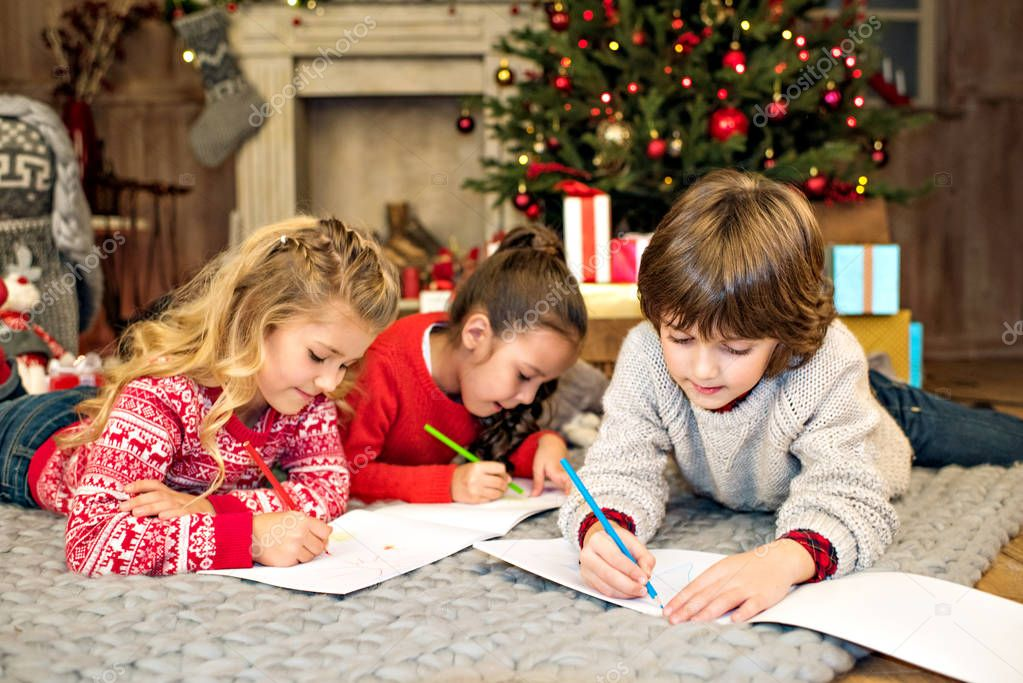 Happy kids drawing picture