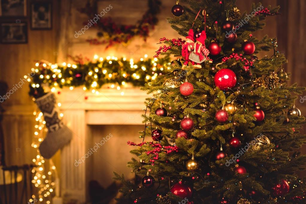 Christmas decorations hanging on fir tree