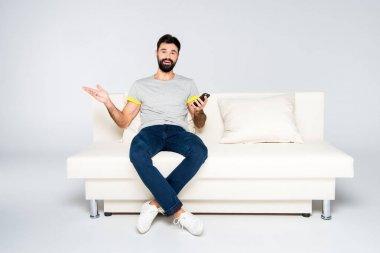 Bearded man using smartphone