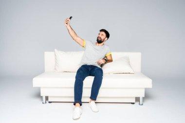Bearded man taking selfie