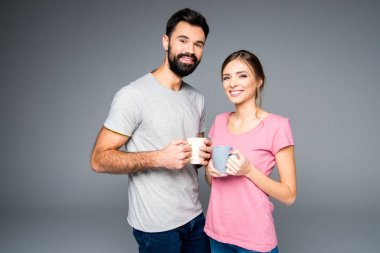 Couple holding cups
