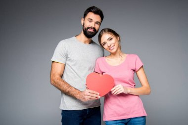 Young couple with red heart