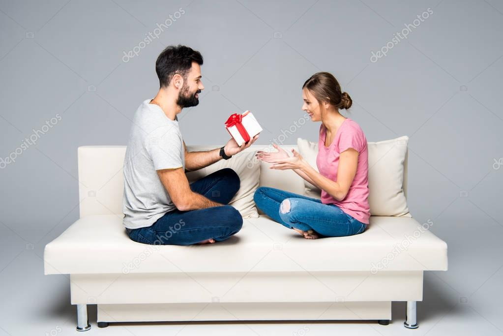 Man giving gift box to woman