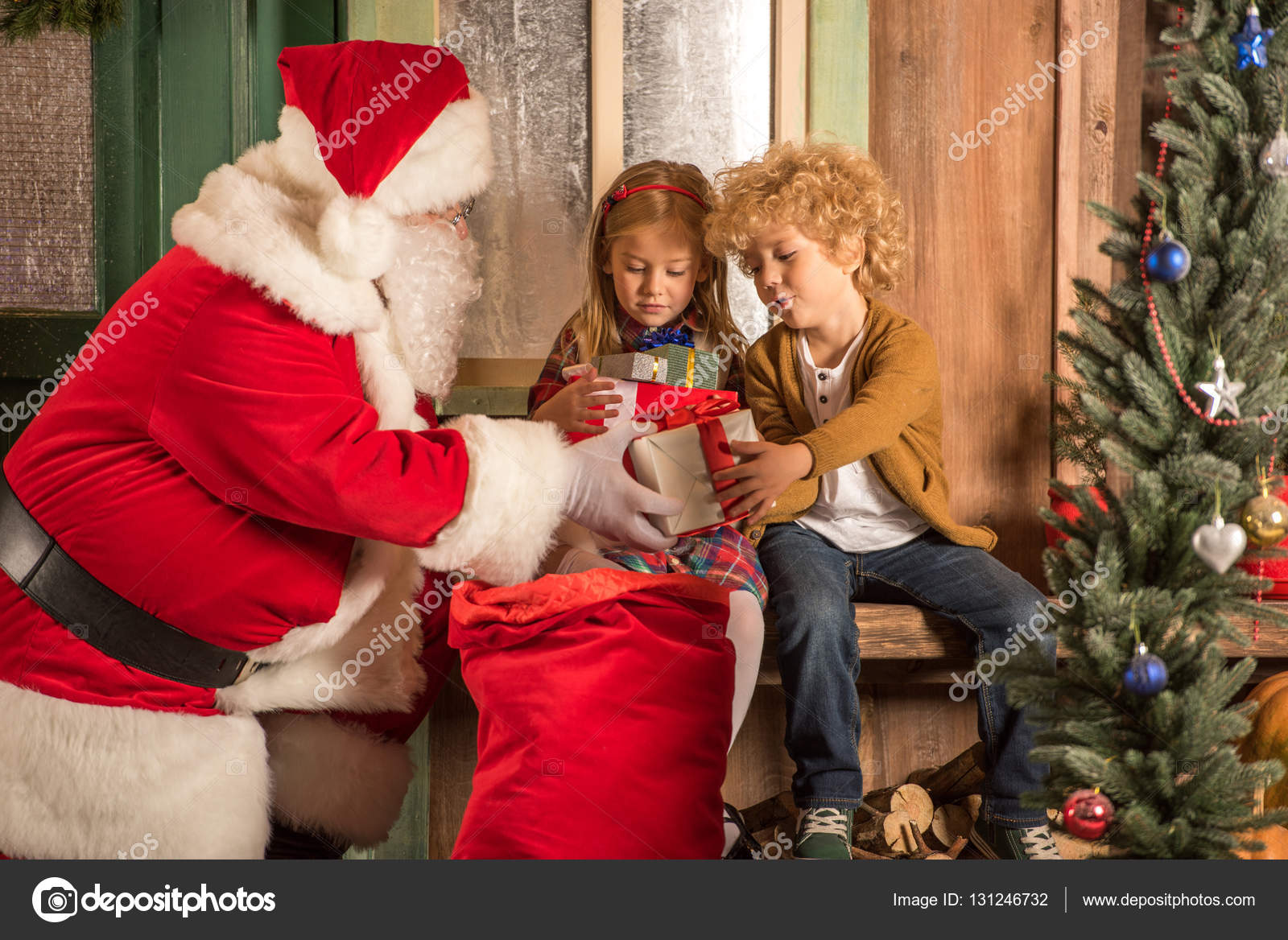 santa claus giving gift boxes to children stock photo - Santa Claus Children