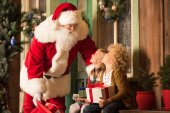 Fotografie Santa Claus and children with gift boxes