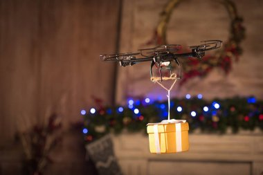 Hexacopter drone flying with gift box