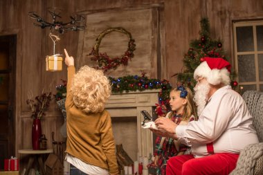 Santa Claus with children using hexacopter drone