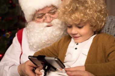 Happy Santa Claus with kid