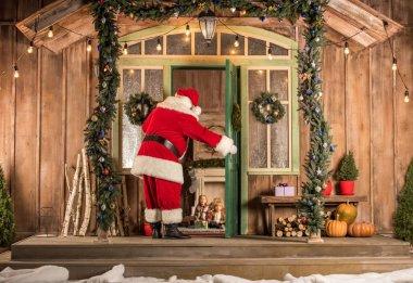 Santa Claus coming to children at Christmas