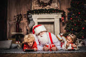 Fotografie Happy Santa Claus with children