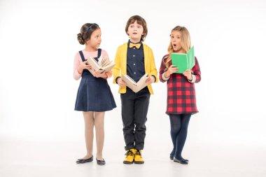 Schoolchildren standing with books