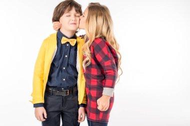 Schoolgirl kissing in cheek schoolboy