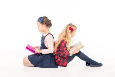 Schoolgirls reading books