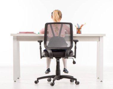 Schoolgirl studying at desk