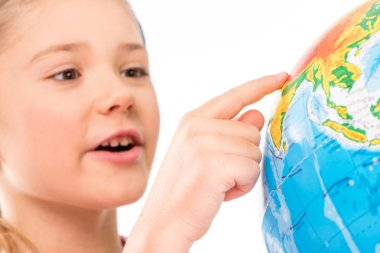 Happy schoolgirl exploring globe