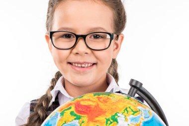 schoolgirl smiling with globe