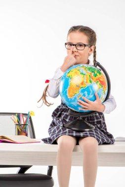 Schoolgirl holding globe