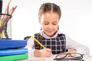 Schoolgirl writing homework