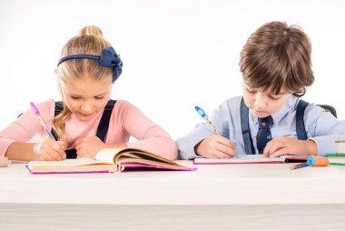 Classmates writing homework in notebooks isolated on white stock vector