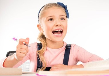 Excited schoolgirl studying on lesson