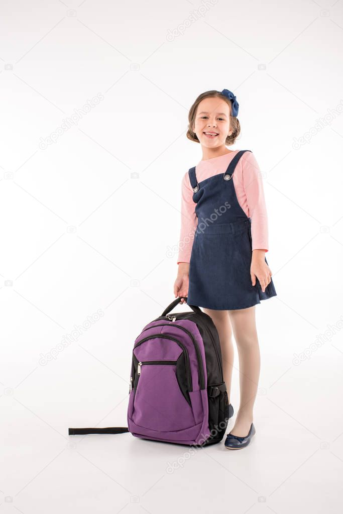 Schoolgirl standing with backpack