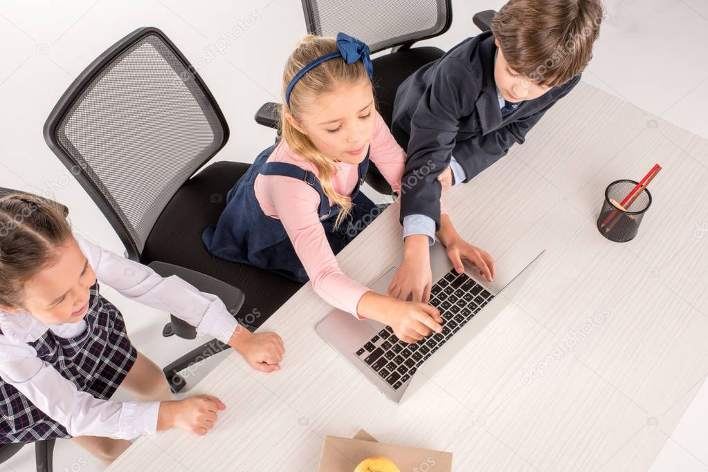 Classmates using laptop
