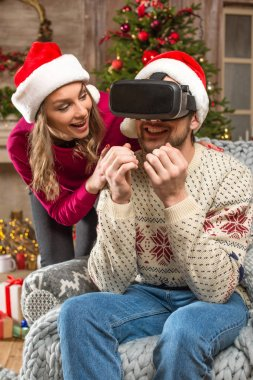 Couple using virtual reality headset