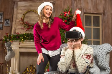 Couple using virtual reality headset