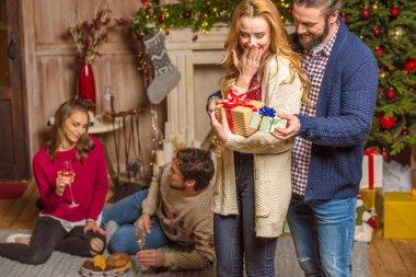 Couple sharing christmas presents