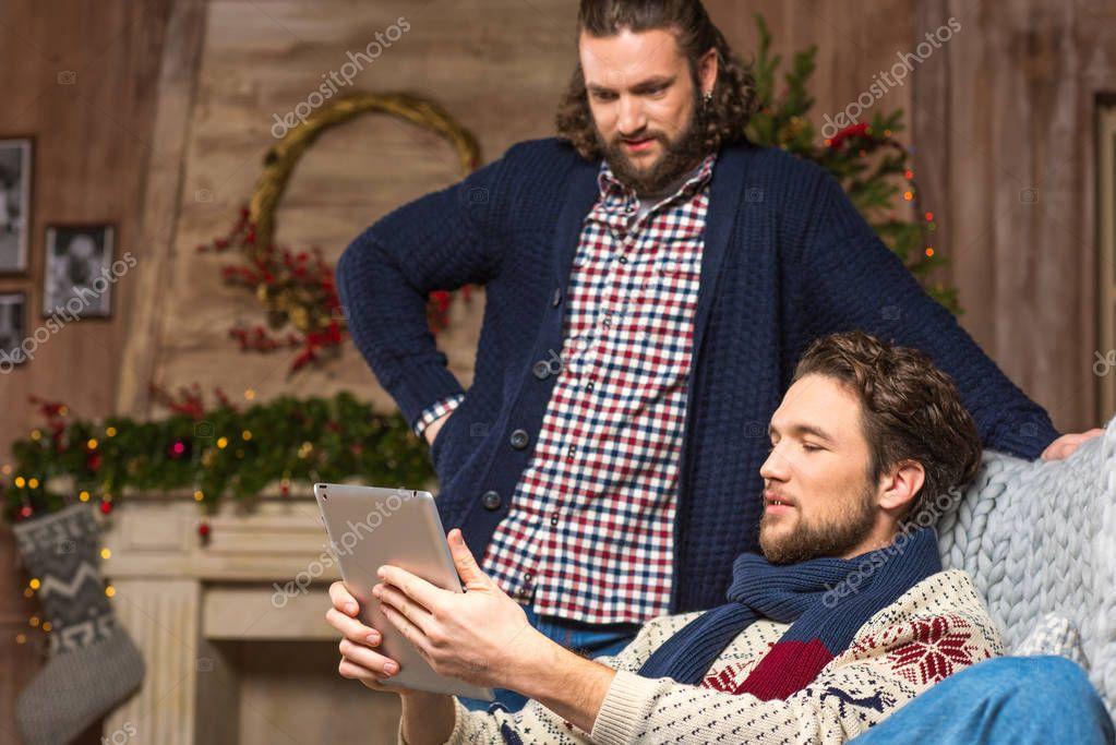 Handsome men using digital tablet