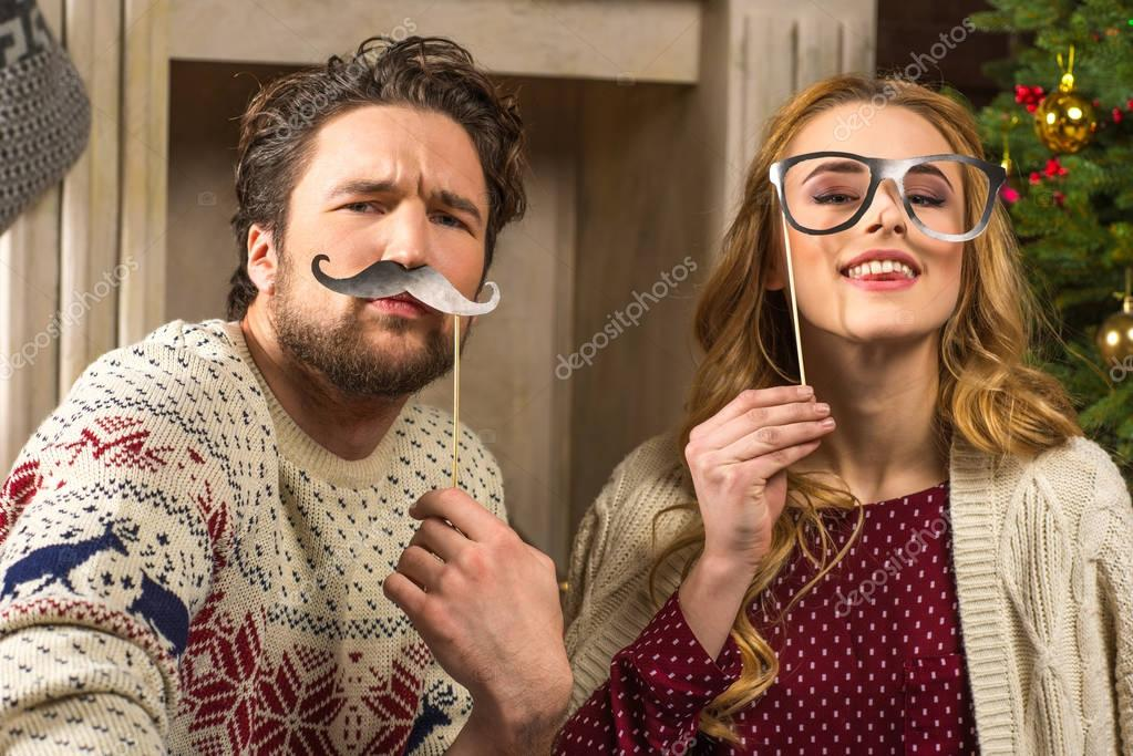 Couple having fun with party sticks