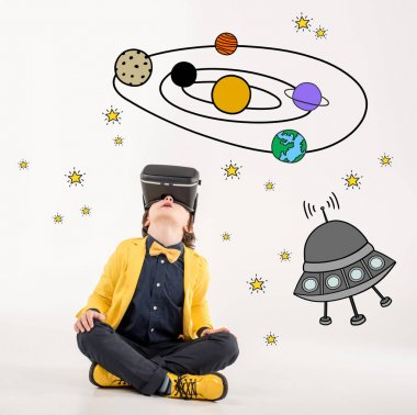 Young boy wearing virtual reality headset, dreaming about space traveling stock vector