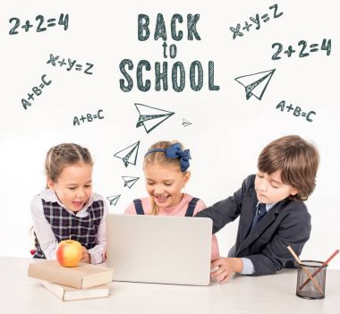 schoolchildren using laptop