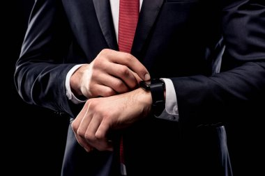Businessman checking smartwatch