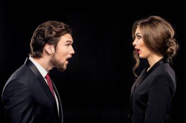 Shocked couple in formal wear