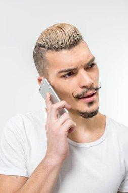Handsome man using smartphone